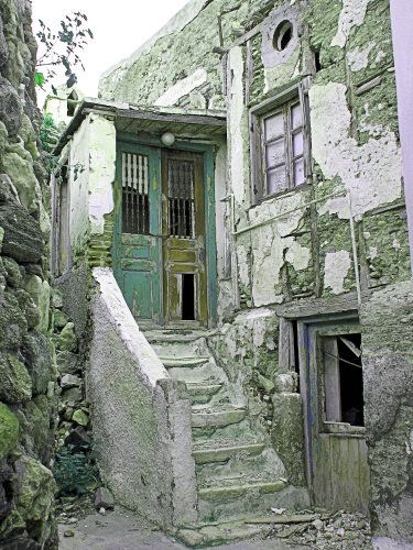 An old house in Naxos.  I took this photo a few years ago - the house is now being restored, and has lost its old character.