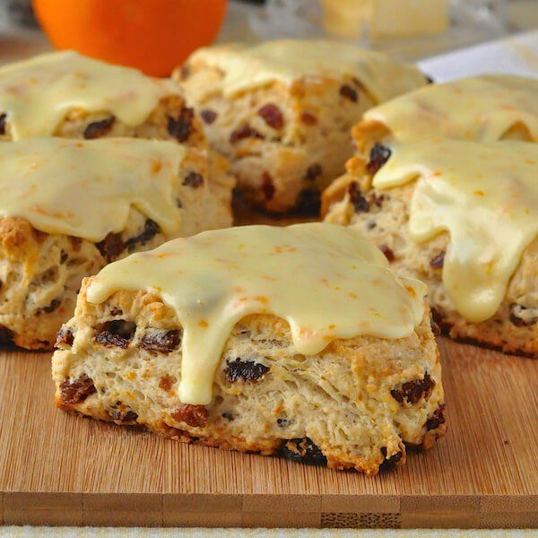 Orange Raisin Scones with Orange Glaze - tender English style scones infused with orange zest & packed with raisins, then topped with a tangy orange glaze.