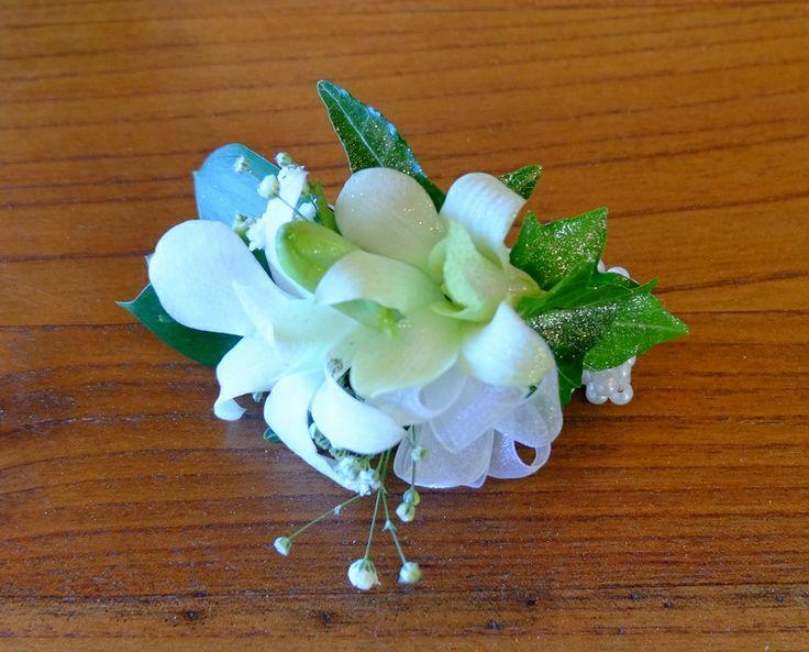 Singapore Orchid, Gypsophila, White Ribbon, White Bracelet - St Kents College Ball 2014 #rubyandblush#corsage#schoolball#prom#aucklandflorist#floristauckland#florist#orchid