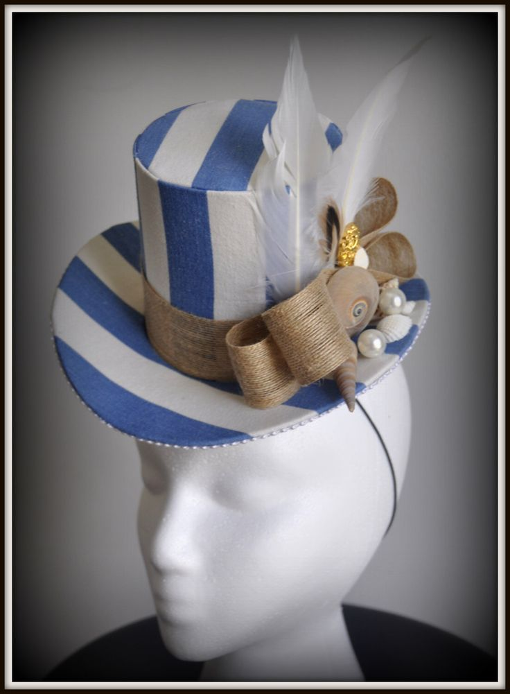 A personal favorite from my Etsy shop https://www.etsy.com/listing/288077875/nautical-stripe-shell-pearl-fascinator