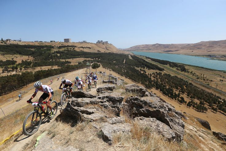 Lukas Fluckiger of Switzerland leads the pack up the climb during the Men's Cross-country Mountain Bike Cycling on day one of the Baku 2015 European Games at Mountain Bike Velopark.