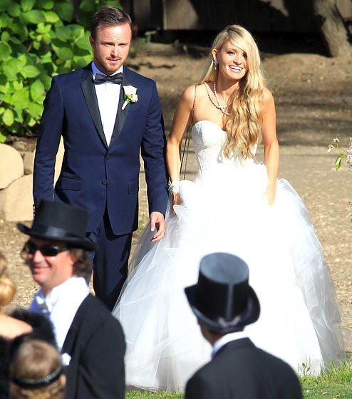"Aaron Paul and Lauren Parsekian The Breaking Bad actor got married at the Cottage Pavilion at Calamigos Ranch in Malibu on May 26. John Mayer performed ""Daughters"" as Parsekian, the co-CEO of Finding Kind Productions, danced with her father. The wedding reception featured a small ferris wheel, a swing ride and a photo booth for the 1920s carnival-themed celebration. A source tells Us Weekly that magician David Blaine performed tricks for guests in a red-and-white striped tent."