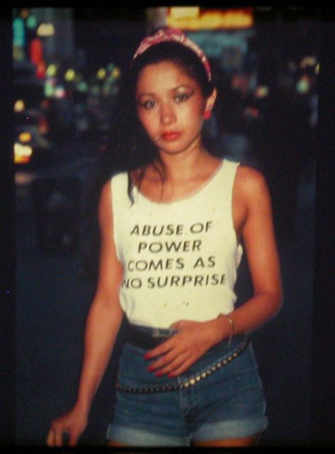 "This is Lady Pink, one of few female graffiti artists active in the '80s. Jenny Holzer, famous for her feminist postmodern ""Truisms,"" designed this shirt and Lady Pink wore it around NYC."
