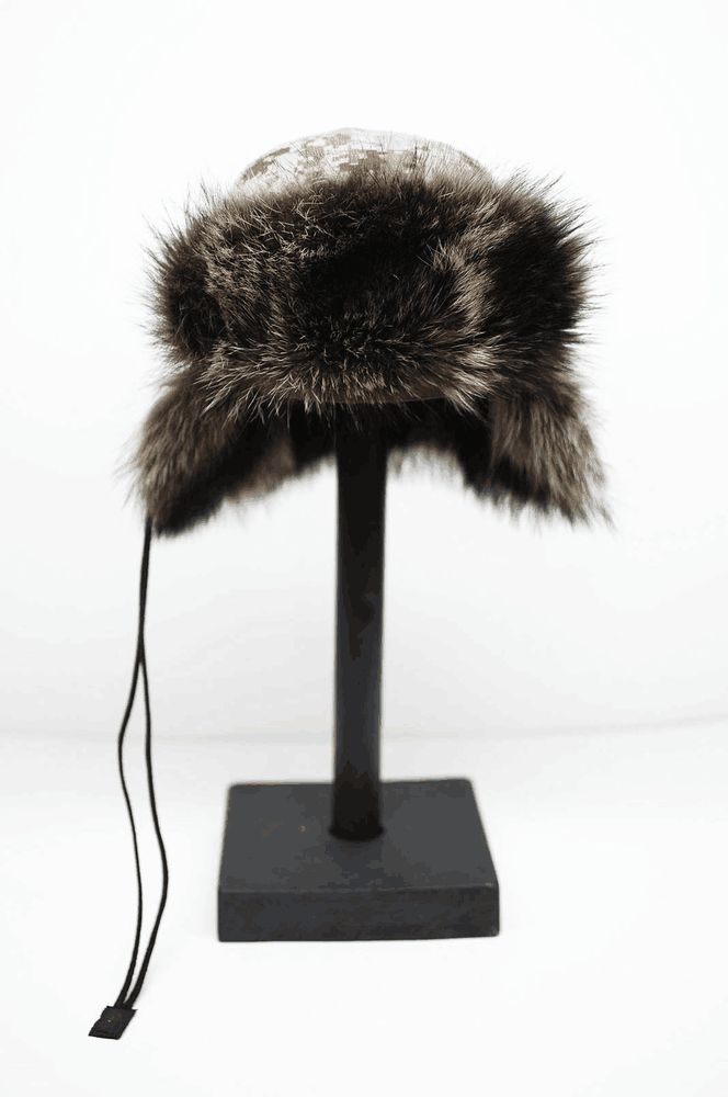 """This CHAPKA is the Original 45new pattern design by Philippe Urban The original wood block design is handcrafted from La Forme ,Paris. Soft shell 3 Layers  Microfiber Polyester TPU membrane Fury Fleece Polyester Canadian raccoon ''ärähkun"""" fur recycle from vintage fur coat. Top stitch tonal. Height of the crown is 11 cm  Elastic headsize."""