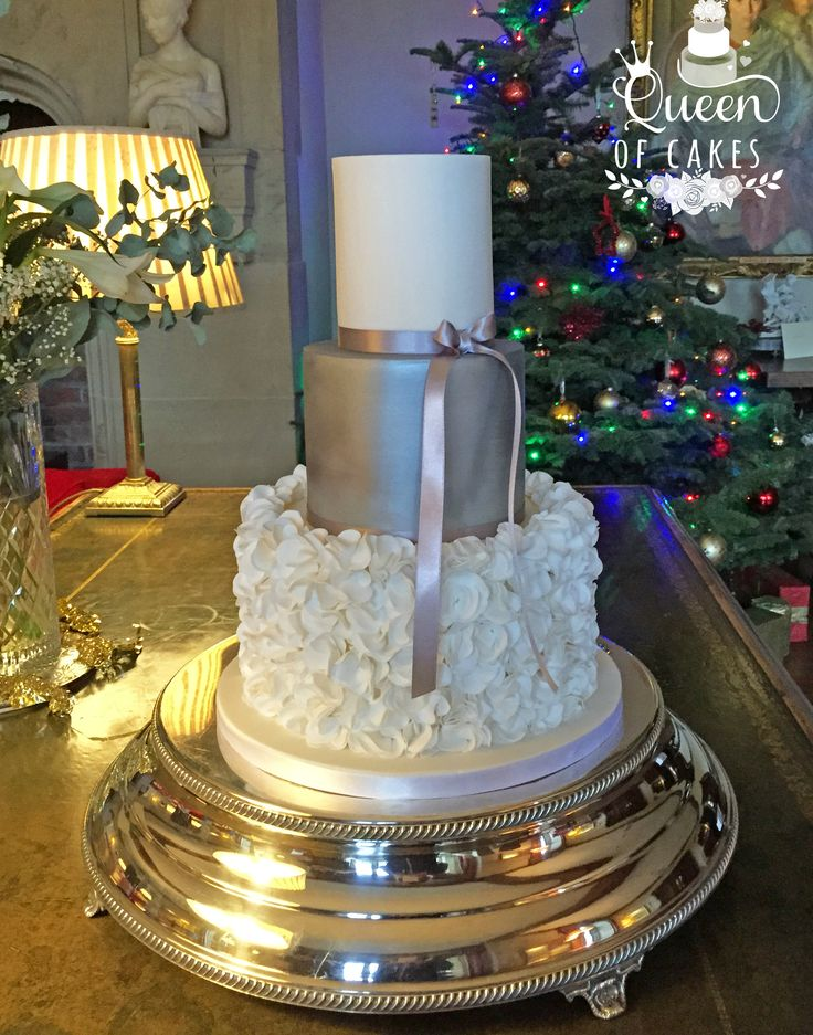 Silver and ruffle wedding cake. Serves 70 guests