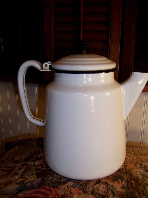 Notice the unique contours of this coffee pot and the square spout. Black trim on white, 11 tall. Would fit well in farmhouse kitchen to