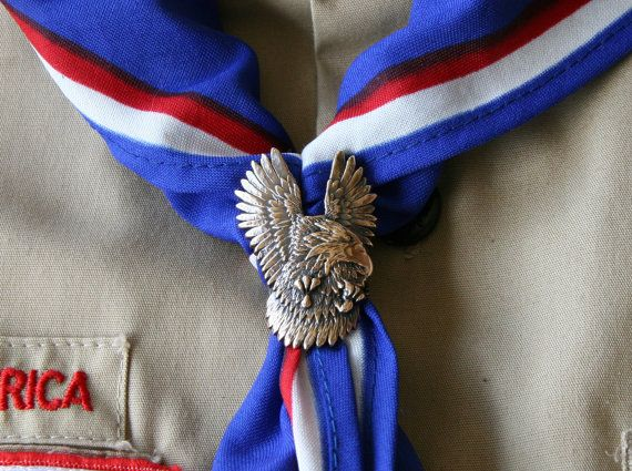 Becoming an Eagle Scout is one of the highest honors which can be bestowed on a young man. Only 3% of all boys who enter Boy Scouts ever make it to the rank of Eagle. Neil Armstrong, Gerald Ford, and Bill Gates are among our nations notable leaders who are also Eagle Scouts. This handcrafted eagle slide is a perfect gift forsomeone who wants honor their special Eagle Scout. This kerchief slide depicts a soaring eagle. His wings are spread as though hes just taken flight. This eagle is like…