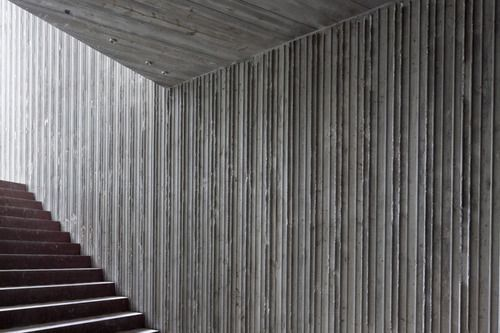 Concrete panels are an innovative and creative way to dress up a wall. With the combination of concrete walls and timber, a room can at once take on an almost masculine sophistication.