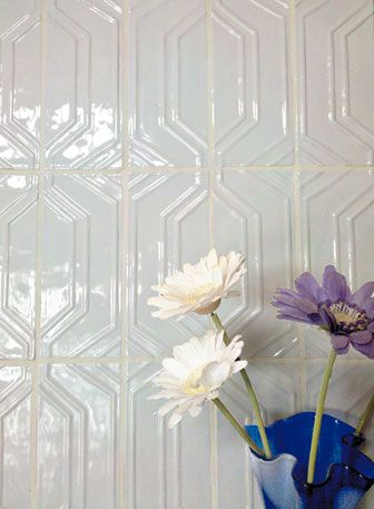 Textured tiles have a softer impact, enhancing the art deco design without being too overpowering