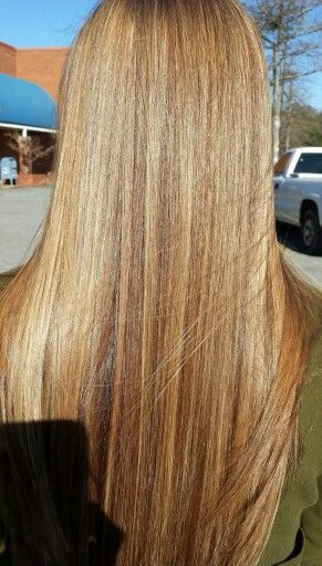 Caramel, strawberry, and mahogany highlights.