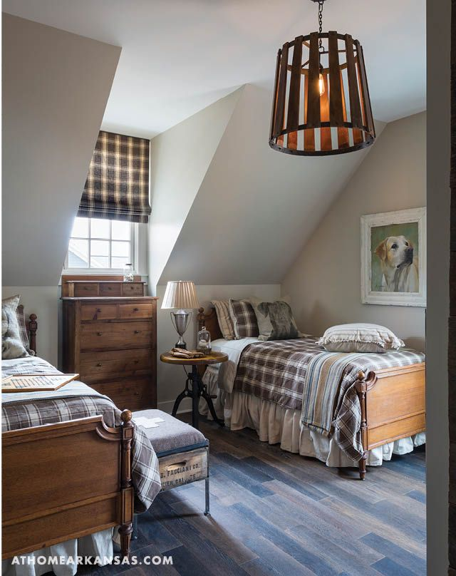 The children's bedrooms are located just off the common area upstairs. Each features wood and iron furnishings from The Park Hill Collection along with bedding that is meant to complement each child's taste.  | Best in Show | At Home in Arkansas | November 2016