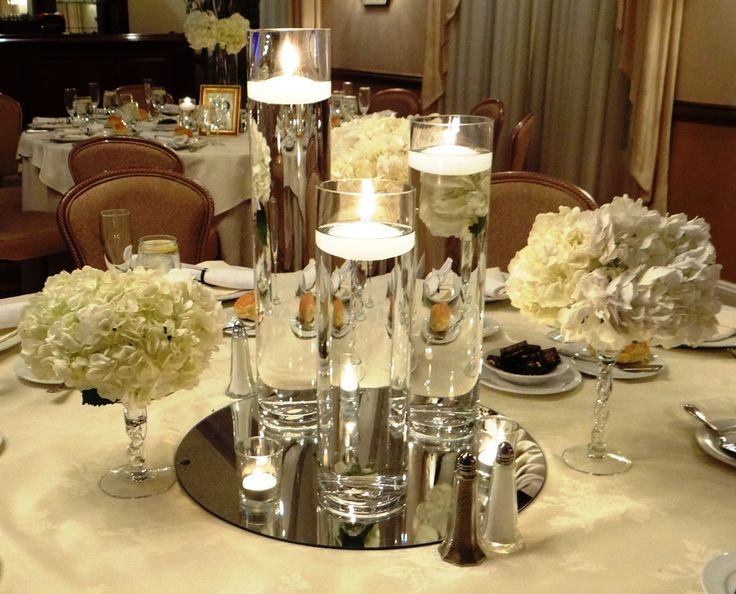 Floating candle centerpiece winter wonderland events for Table arrangements