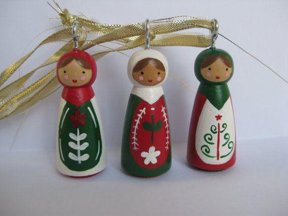 As ornaments! Love the faces. -kss Matryoshka peg doll ornaments