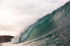 Clean surf conditions at Aramoana Beach, Dunedin, New Zealand.