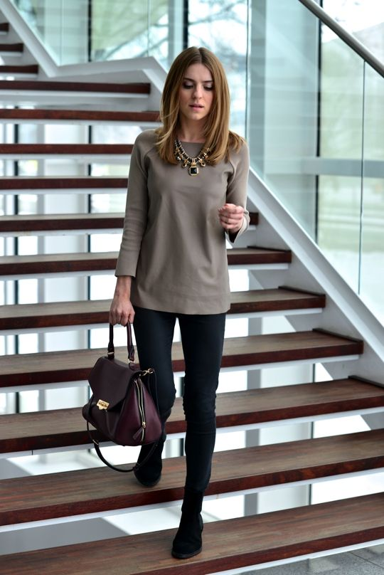 Slim black pants, black shoes, plain solid long sleeved top, statement necklace