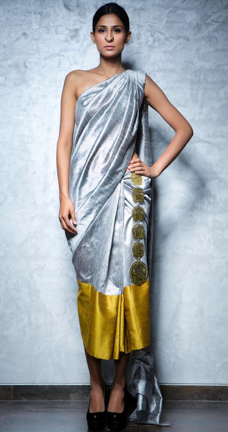 Silver and gold colour blocked silk short sari by NIKHIL THAMPI http://www.perniaspopupshop.com/lakme-fashion-week/nikhil-thampi/nikhil-thampi-silver-gold-short-sari-nktlfw081305.html