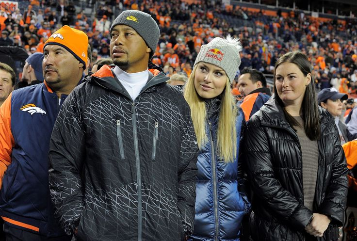 Tiger Woods and Lindsey Vonn watch from the sidelines before the start of the game. The Denver Bronc... - John Leyba/The Denver Post/Getty Images
