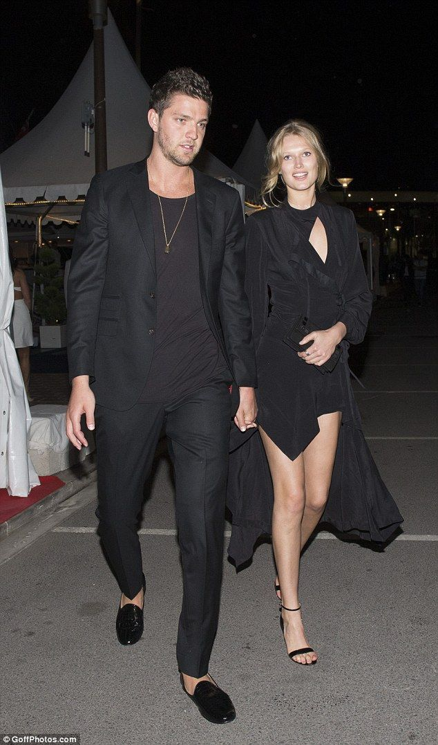 Leggy display: Model Toni Garrn looked sensational in a black dress with a high hemline as she left The Weinstein Company's Hands Of Stone bash in Cannes on Saturday, hand-in-hand with her man