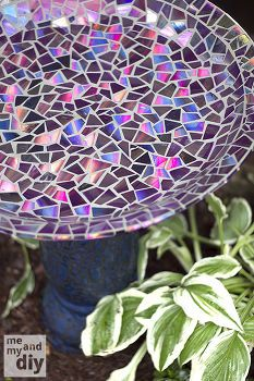 mosaic tile birdbath using recycled dvds, diy home crafts, gardening, repurposing upcycling, Even with no experience in mosaics or tiling our bird bath face lift turned out just as I had hoped Now I m thinking about all the other things I could do gazing balls garden stakes water fountains etc The sky s the limit