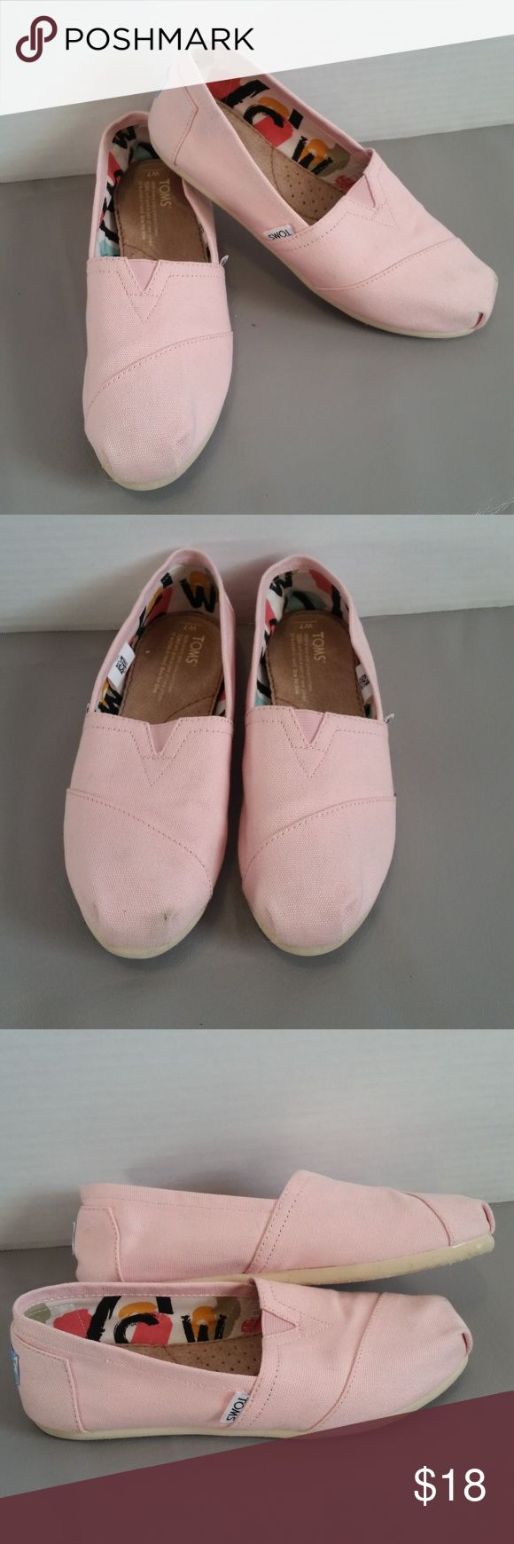 Pale pink Toms Adorable pale pink canvas Toms!  Classic Toms styling in a lightweight, comfortable canvas General very light wear/smudges small spot on the corner of the right toe light smudge on the back of the right heel at the bottom  No wear to the inside of the shoe Overall very good condition! TOMS Shoes Flats & Loafers