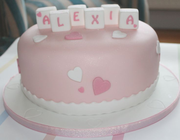 Alexia's Christening cake - chocolate on the inside, pretty pink on the outside.