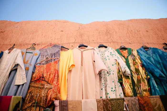 CLOTHING: In the photo above it shows popular clothing that people wear in Morocco. Girls often wear skirts that cover their knees and shirts that cover their arms. Men wear short sleeved shirts or long sleeve depending on the weather. Boys and girls wear sandals because of the heat.