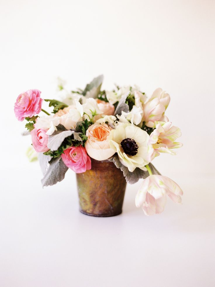 #dusty-miller, #anemone, #tulip, #rose, #sweet-pea, #floral-arrangement, #pastels, #spring, #light-pink  Photography: Paula Player Photography - paulaplayer.com/  View entire slideshow: Pretty Vases for Spring on http://www.stylemepretty.com/collection/1156/