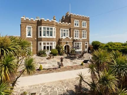Bleak House, Broadstairs, Kent,  England. Former home of Charles Dickens, you can now stay here and visit his study where David Copperfield was written. It also has The Charles Dickens suit and the bed was often slept in by Queen Victoria which was originally in the Bull Hotel in Rochester, Kent. B. Lowe