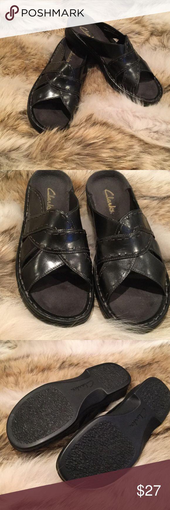 Ladies Clarks sandals black Ladies black. Leather Clarks sandal size 9 worn  one time. Flat style slide on Clarks Shoes Sandals