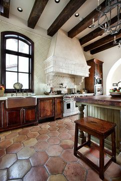 Lake Conroe Spanish - The green stained kitchen island is a handsome centerpiece to this Spanish-style home!