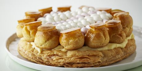 This classic French torte is named after St. Honoré, the patron saint of pastry chefs. Not a cake-based confection, this torte has a puff pastry base, topped with pastry cream and whipped cream, surrounded by profiteroles dipped in caramelized sugar, their sugary tops resembling the halos of saints.Makes 1 9-inch torte.