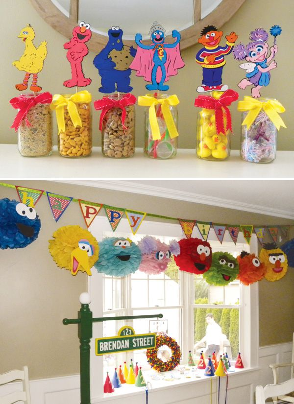 AMAZING ideas for Sesame Street party decorations and games.  LOVE the flying Grover game.  If only I could get my husband to make this ;)