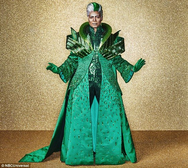 Emerald City: Queen Latifah wears a wig and an intricate costume for her role as The Wiz i...