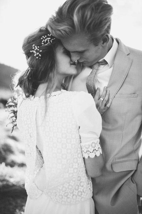 Gorgeous couple... love the baby's breath head wreath