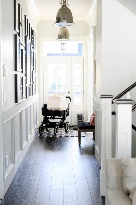 Home Tour | Monika Hibbs  Door w transom & sidelights. Classic wood and white stairs.