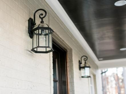 Lanterns on each side of the mahogany front door with glass inserts illuminate the entry and welcome visitors inside.