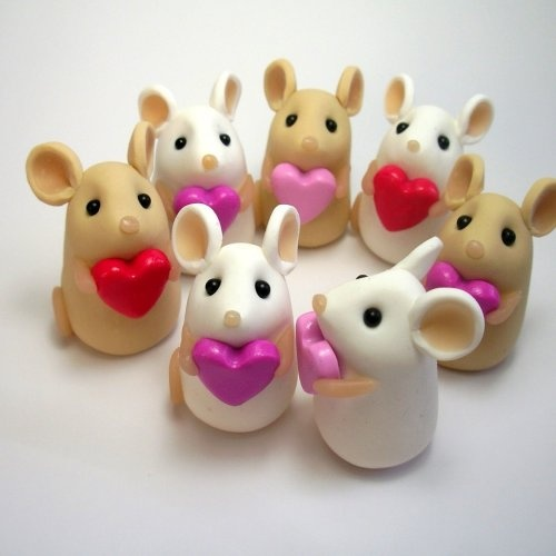 My mom collected mice..  I know if she where still with us she would have loved these little guys..mom this picture is pinned for you :-)   You can find it here at this link.. on artfire.  http://www.artfire.com/ext/shop/product_view/quernuscrafts/2824373/tiny_love_mouse_with_heart/fine_art/sculpture/animal/polymer_clay