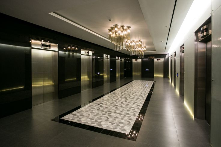 Modern Lobby With Backlit Glass And Lacquered Panels At