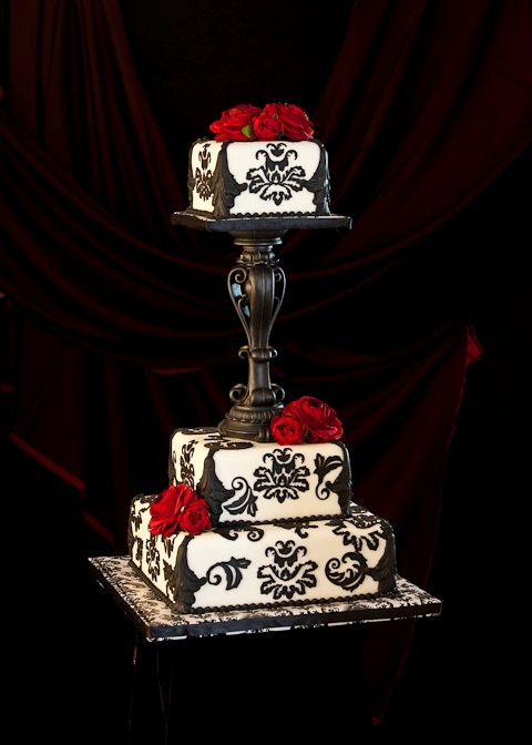 Cakes, cakes, cakes! #cakes One of my favorite wedding cakes!  Beautifully done in black and white damask and highlighted with red roses!  STUNNING!