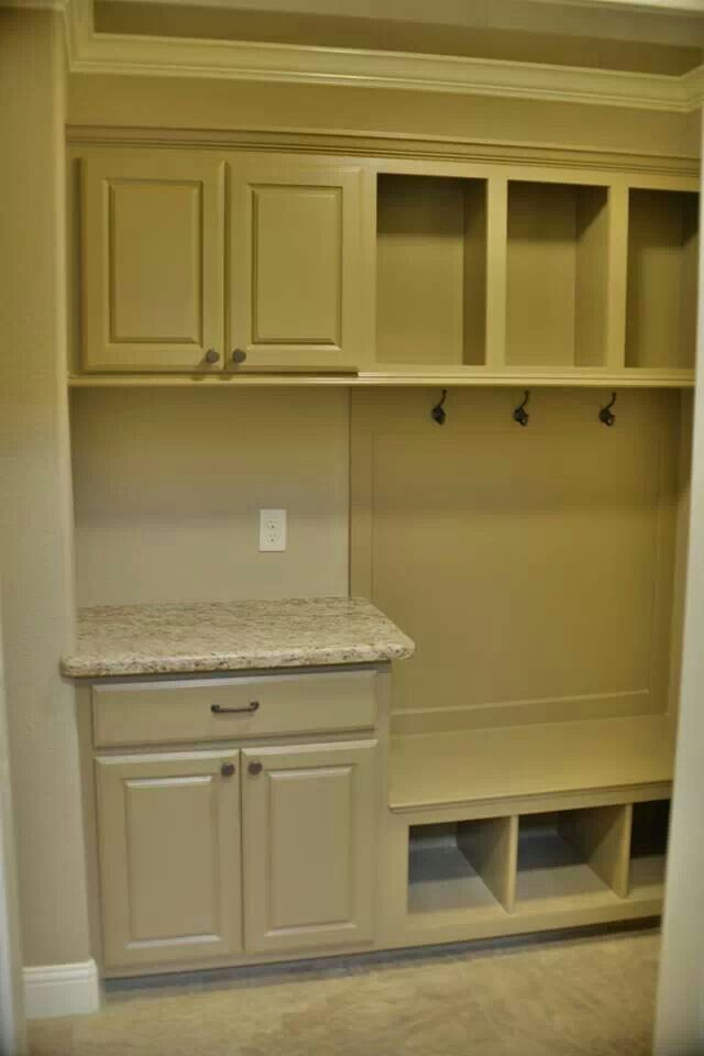 I like the idea of putting a small cabinet with a countertop in the mud room. Maybe with a basket for keys, phones, etc.