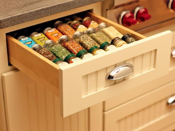 Easy-to-Grab Spices - Storing spices in a drawer rather than a wall-mounted rack ensures seasonings are handy for cooking while preserving their delicate flavors by protecting them from sunlight, moisture and heat.