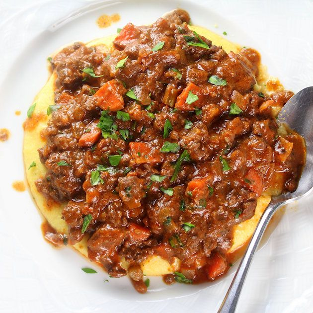 Parmesan Polenta Bolognese: Hearty meat sauce layered over creamy Parmesan polenta & topped off w/fresh Italian parsley + grated Parmesan.  http://tasteandsee.com
