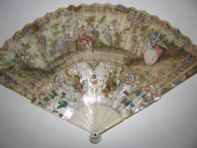 Antique fan with carved mother-of-pearl handle; c. 1800.