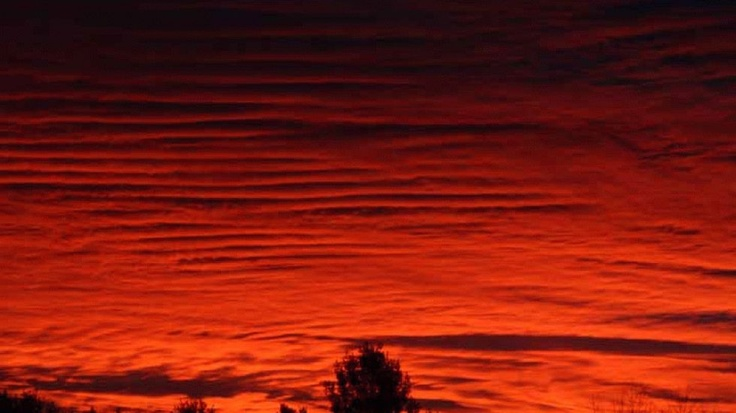 The sky over Western New Hampshire glowed red at sunrise Sunday, October 28, 2012.  iWitness Jmarr