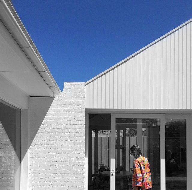 Painted white brick with weatherboard and VJ. Kennedy Nolan architects.