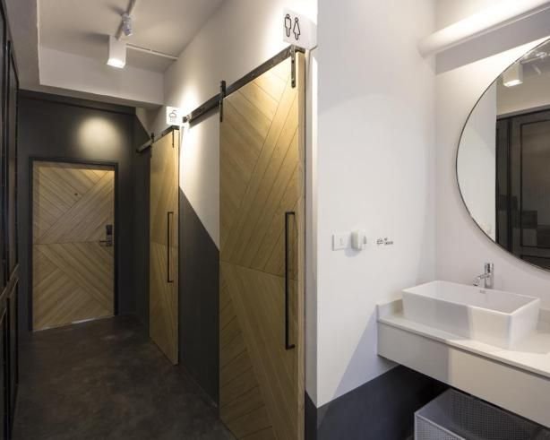 Bed One Block Hostel Design - bathrooms. This slimlined hostel design in Bangkok, Thailand is genius!