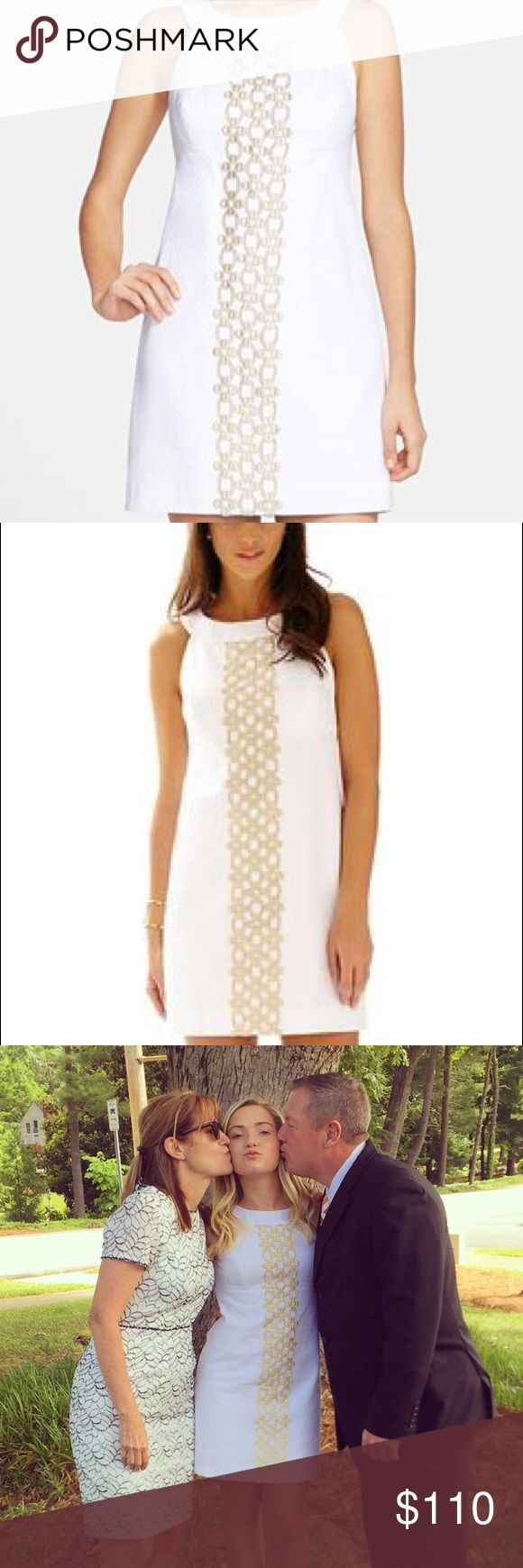 Lilly Pulitzer Jacqueline shift dress white/gold A-line shift dress beautiful detail and amazing white dress to have, fits perfectly, literally worn one time for my graduation, size 2, open to offers Lilly Pulitzer Dresses