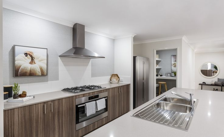 Galley kitchen with 1200mm Caesarstone island bench, 900mm stainless steel oven…