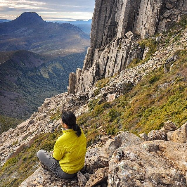 Wilderness daydreaming on an ascent of Barn Bluff. Located within the Cradle Mountain-Lake St Clair National Park, Barn Bluff is Tasmania's fourth highest mountain and features as an optional side-trip on the iconic Overland Track. Image Credit: Cole Moszynski
