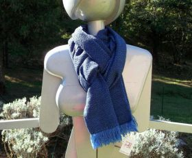 Scarf hand woven on traditional looms. The Warp in merino wool is in various shades of light blue and the texture in dark blue. #artigianato #madeinitaly #sciarpa #scarf